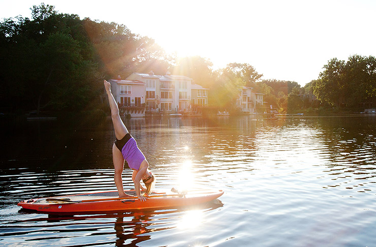 Yoga on paddle board at Lake Anne in Reston, Virginia
