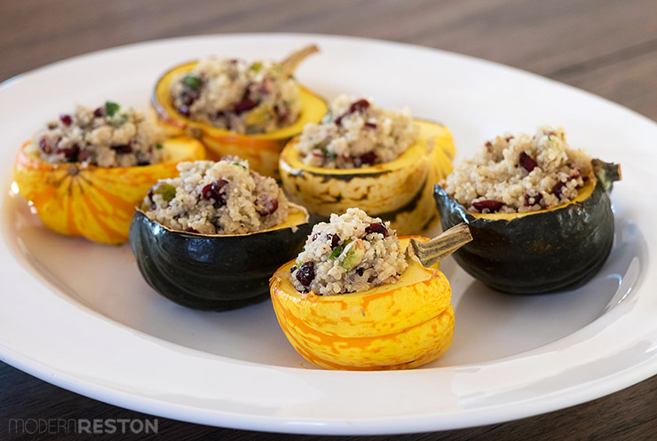 Stuffed acorn squash with quinoa, cranberries, and pistachios