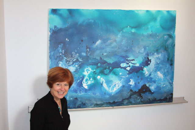 Celeste Friesen-Nikkel with her work, Rumours of Another World