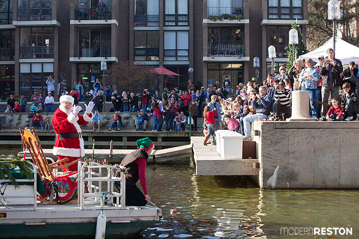 Santa arrives by boat at Jingle on Lake Anne in Reston, Virginia