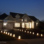 Luminaries on front lawn for Christmas decorations